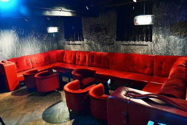 red sofa in bar 13