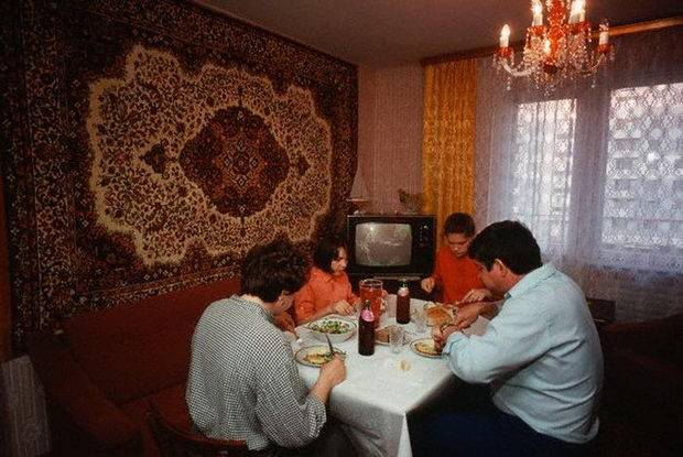 soviet family having dinner old photo
